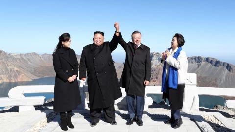A handout photo shows South Korean President Moon Jae-in and North Korean leader Kim Jong Un visiting Mount Paektu.