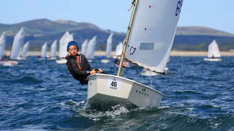 """Andy Green photographed a young sailor racing at the Optimist Nationals in Pwllheli, Wales. """"I love this image as it shows the concentration of the child's face,"""" he says."""