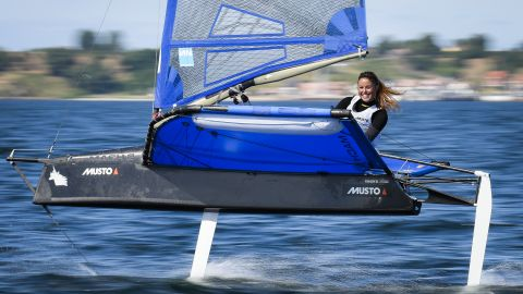 """Martina Orsini photographed Franziska Maege as she flew above the water during the Moth European Championship in Sweden.  """"[Maege] is a true role model, always smiling as she competes and showing her love for foiling,"""" says Orsini."""