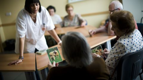 BARCELONA, SPAIN - AUGUST 02:  An elderly woman holds a picture of a sheep as she try to remenber the name of the animal during a memory activity at the Cuidem La Memoria elderly home, which specializes in Alzheimer patients on August 2, 2012 in Barcelona, Spain.