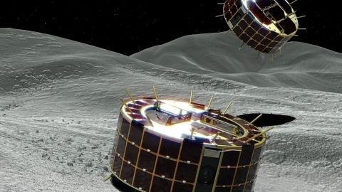 Illustration of Rover-1A (back) and Rover-1B (foreground) from MINERVA-II1 as they explore the surface of Ryugu.