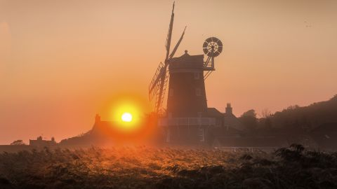 <strong>Cley next the Sea, England: </strong>The 18th-century Cley Windmill is lit dramatically at sunrise on the Norfolk coast in England's East Anglia.