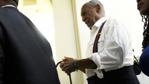 """Bill Cosby is taken away in handcuffs after he <a href=""""https://www.cnn.com/2018/09/25/us/bill-cosby-sentence-assault/index.html"""" target=""""_blank"""">received a prison sentence of three to 10 years</a> in September 2018. The entertainer had been found guilty of drugging and sexually assaulting Andrea Constand 14 years ago."""