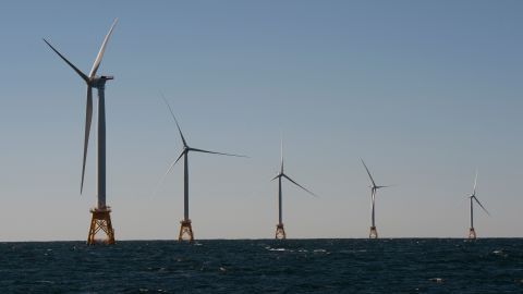 Wind turbines, of the Block Island Wind Farm, tower over the water on October 14, 2016 off the shores of Block Island, Rhode Island. The first offshore wind project in America has created more than 300 construction jobs and will deliver the electricity demands for the entire island.  / AFP / DON EMMERT        (Photo credit should read DON EMMERT/AFP/Getty Images)