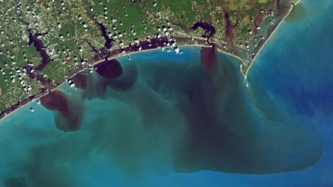 NASA image shows how  soils, sediments, pollution and other debris have discolored the White Oak River, New River and Adams Creek, and their outflows along the coast and into the ocean.