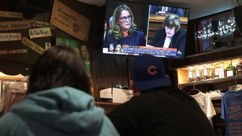 Patrons watch the television at the Billy Goat Tavern during the Senate Judiciary Committee on Capitol Hill where professor Christine Blasey Ford was testifying about being sexually assaulted by Supreme Court nominee Brett Kavanaugh on September 27, 2018 in Chicago, Illinois.
