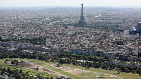 An aerial photograph of Longchamp showing Paris and the Eiffel Tower in the distance. The racecourse has undergone a $145M revamp.
