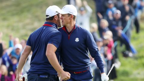 Europeans Jon Rahm (left) and Justin Rose celebrate during the Friday morning four-ball matches. The pair lost their lead to Tony Finau and Brooks Koepka.