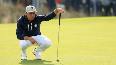 Johnson was paired with Rickie Fowler, and together they won the first point Friday for Team USA.