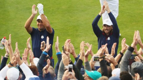 Molinari (left) and Fleetwood went up against the American pair of Woods and Patrick Reed and secured a crucial point Friday for the Europeans.