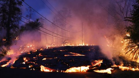 Lava from a Kilauea volcano fissure advances up a residential street in Leilani Estates, Hawaii, on May 27.