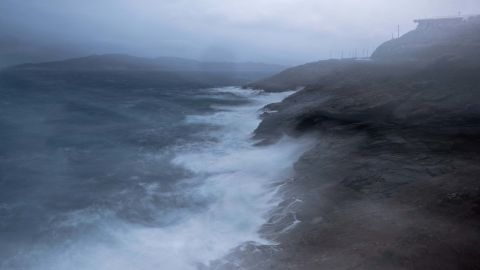 Waves crash on rocks near the port town of Lavrio south of Athens, on Thursday, Sept. 27