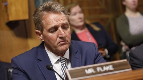 Senator Jeff Flake, a Republican from Arizona, arrives for a Senate Judiciary Committee markup hearing in Washington, D.C., U.S., on Friday, Sept. 28, 2018. Supreme Court nomineeBrettKavanaughappears headed toward approval by the Senate Judiciary Committee after pivotal Flakesaid he'll vote to confirm the nominee. Photographer: Aaron P. Bernstein/Bloomberg via Getty Images