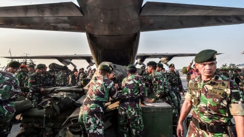 Indonesian soldiers load emergency supplies onto a military plane at a base in Jakarta, Indonesia's capital, before heading to Palu on September 29.