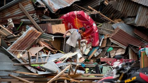 A man searches for his belongings in the ruins of his house in Palu on Saturday, September 29.