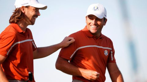 Team Europe's Francesco Molinari and Tommy Fleetwood talk Saturday during the foursomes matches.