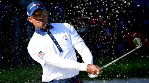 Tiger Woods of the United States plays out of a bunker during the Saturday afternoon foursomes matches.