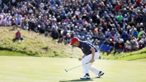 Justin Thomas of the US celebrates on the green during singles matches of the Ryder Cup at Le Golf National on Sunday, September 30, in Paris, France.