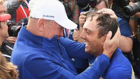 Francesco Molinari of Europe, right, celebrates winning the Ryder Cup with team captain Thomas Bjorn on Sunday.