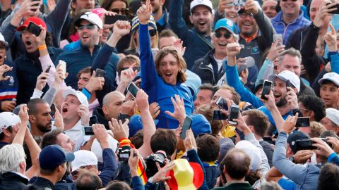 Team Europe's Tommy Fleetwood celebrates with spectators after winning the Ryder Cup on Sunday.