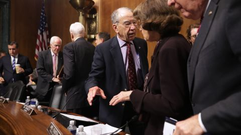 Senate Judiciary Committee Chairman Charles Grassley (R-IA) (C) talks with ranking member Sen. Dianne Feinstein after the committee voted out Supreme Court nominee Judge Brett Kavanaugh at the conclusion of a mark-up hearing in the Dirksen Senate Office Building on Capitol Hill September 28, 2018 in Washington.