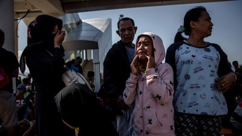 A young girl cries outside the Palu airport after it reopened on October 1. Hundreds rushed to the airport hoping to catch one of the few flights out of the area.