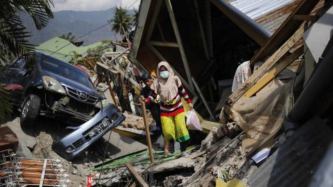 A woman makes her way through rubble in the Palu neighborhood of Balaroa on October 2.