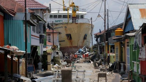 A ship that was swept ashore during the tsunami rests near houses in Donggala on October 2.