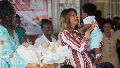 US First Lady Melania Trump holds a baby during a visit to the Greater Accra Regional Hospital in Accra, on October 2, 2018, as she begins her week long trip to Africa to promote her 'Be Best' campaign. (Photo by SAUL LOEB / AFP)        (Photo credit should read SAUL LOEB/AFP/Getty Images)