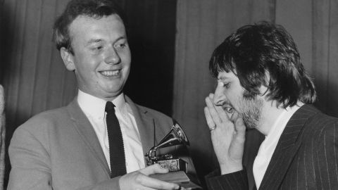 Ringo Starr congratulates Geoff Emerick on his Grammy Award at Abbey Road studios in March 1968.