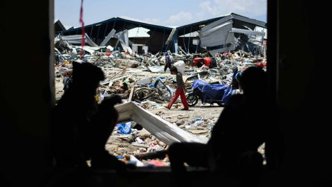Quake survivors salvage items from the debris of a factory complex in Palu.