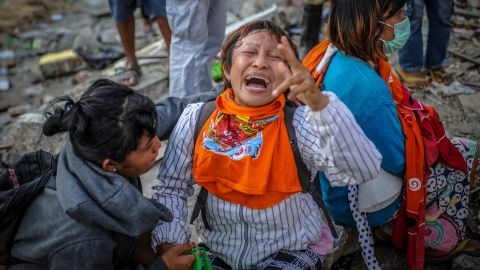 A woman mourns in Palu on Tuesday, October 2, after her relatives were found to have died in the earthquake.