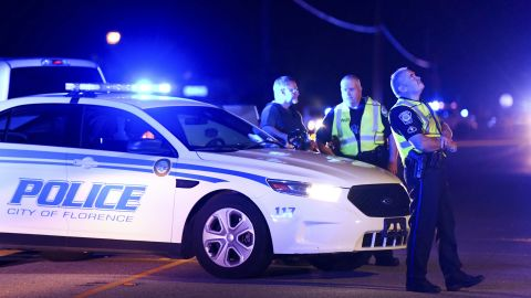 Authorities direct traffic Wednesday near the shooting scene in Florence, South Carolina.