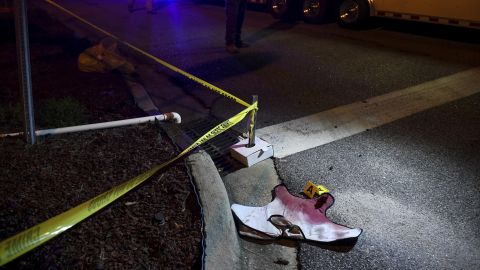 Blood-soaked evidence lies in the Florence neighborhood where law enforcement officers were shot.