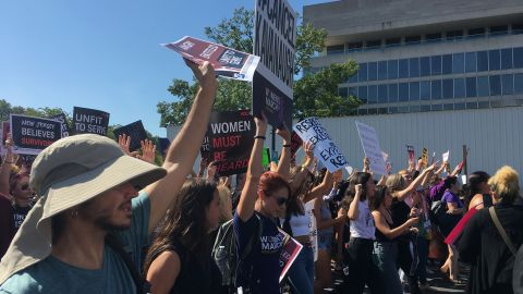 Protesters opposed to Brett Kavanaugh's nomination to the Supreme Court march through the streets of Washington on October 4, 2018.
