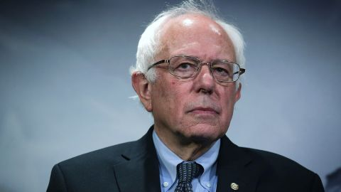 US Sen. Bernie Sanders (I-VT) listens during a news conference about private prisons September 17, 2015 on Capitol Hill in Washington, DC. Sanders was joined by Rep. Keith Ellison (D-MN) to announce that they will introduce bills to ban private prisons.