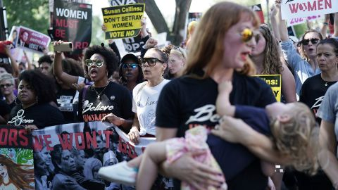 Demonstrators shout slogans as they march toward the US Supreme Court for a rally on October 4, 2018 in Washington, DC.
