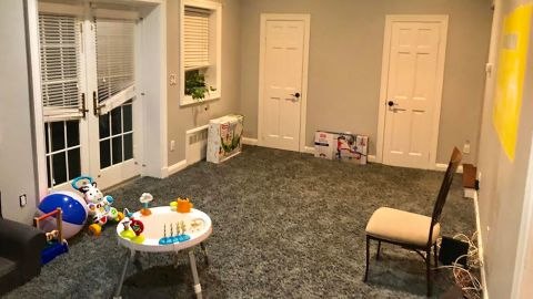 The playroom right after we moved in. Drab, empty, in need of direction.