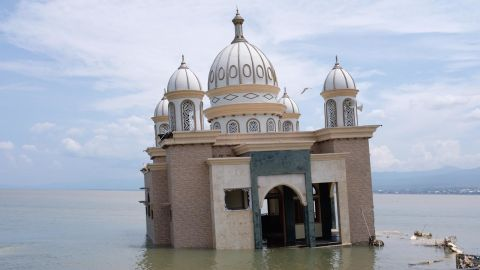 A mosque lies abandoned off the Palu coastline on Thursday. Even before the tsunami, locals called it the 'floating mosque' because it was on a jetty off the beach.