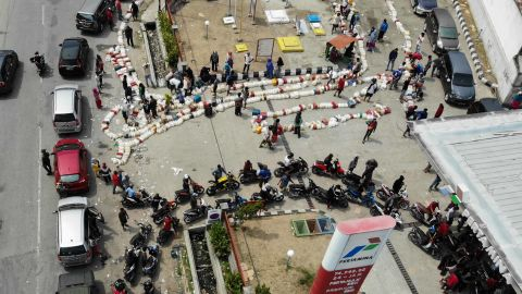 This aerial image shows local residents lining up for gasoline in Palu on October 4.