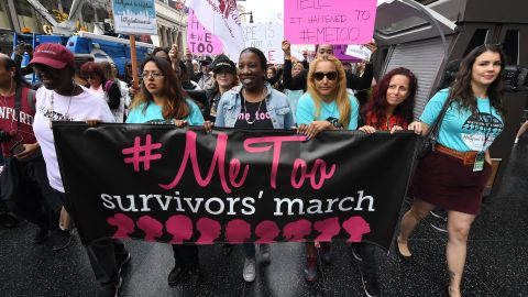 Women who are survivors of sexual harassment, sexual assault, sexual abuse and their supporters protest during a #MeToo march in Hollywood, California on November 12, 2017. Several hundred women gathered in front of the Dolby Theatre in Hollywood before marching to the CNN building to hold a rally.