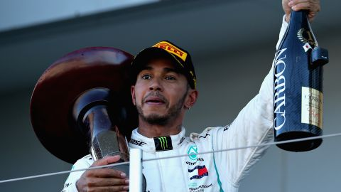 Race winner Lewis Hamilton had plenty to celebrate after claiming victory in the Japanese GP at Suzuka to lead the world championship by 67 points with four rounds remaining.