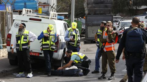 Israeli Zaka volunteers gather at the site of the attack at the Barkan Industrial Park on Sunday.