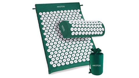 """<strong>Acupressure Mat and Pillow Set by AIKOTOO ($54.99, </strong><a href=""""https://amzn.to/2Px08oD"""" target=""""_blank"""" target=""""_blank""""><strong>amazon.com</strong></a><strong>)</strong>"""