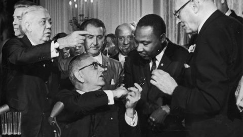 President Lyndon Johnson greets the Rev. Martin Luther King Jr. at the signing of the 1964 Civil Rights Act.