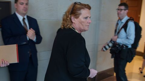 US Senator Heidi Heitkamp (2R) (D-ND) walks out of a room after reading the report on the FBI investigation into Supreme Court nominee Brett Kavanaugh on Capitol Hill in Washington, DC on October 4, 2018. (Photo by ANDREW CABALLERO-REYNOLDS / AFP)        (Photo credit should read ANDREW CABALLERO-REYNOLDS/AFP/Getty Images)