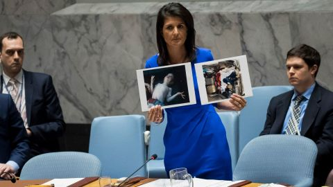 NEW YORK, NY - APRIL 5: U.S. Ambassador to the United Nations Nikki Haley holds up photos of victims of the Syrian chemical attack during a meeting of the United Nations Security Council at U.N. headquarters, April 5, 2017 in New York City. The Security Council is holding emergency talks on Wednesday following the worst use of chemical weapons in Syria since the Ghouta attack in 2013. (Photo by Drew Angerer/Getty Images)