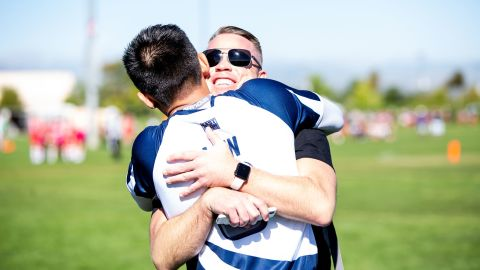 Though competition on the field is fierce, teammates and opponents often embrace afterward.