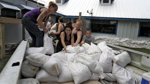 Krystal Day, left, leads a sandbag assembly line at the Old Port Cove restaurant in Ozello, Florida, on October 9.