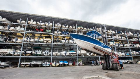 Workers scramble to store boats at Shields Marina in St. Marks.